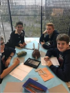 7th graders, inspired by the African art they saw. create their own take on it...