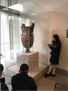 Sixth graders pondering a Greek urn at the Legion of Honor...